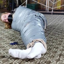 Mummification Bondage - Ariel Anderssen is Mummified to Pay Off Husband's Debt! - Ariel go ballistic, screaming into the gag and struggling!