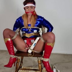 Cosplay Bondage - Ultragirl's Orgasmic Ordeal - UltraGirl is bound to a chair - The more pain, the greater the pleasure
