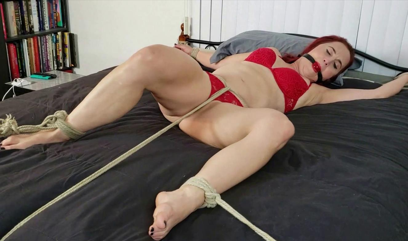 Rope Bondage - Davina Carrington Pays The Rent Spread Eagle Tied - Davina is tightly bound to the bed in a spread-eagled position with a crotch rope