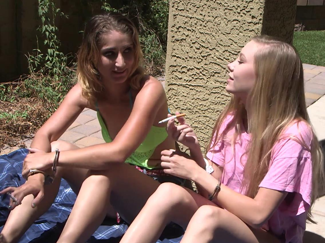 Pink-Cuffs - Lisa and Kenzie wear handcuffs - Handcuffed cuties smoking