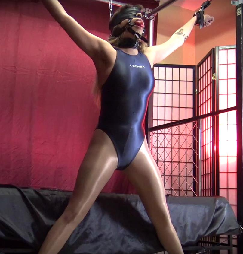 In an awkward position - Shinybound Gypsy Bae is Locked Up - Part 1 of 2 - Gypsy Bae is padlocked tightly into a harness ballgag and chained - Leather Bondage