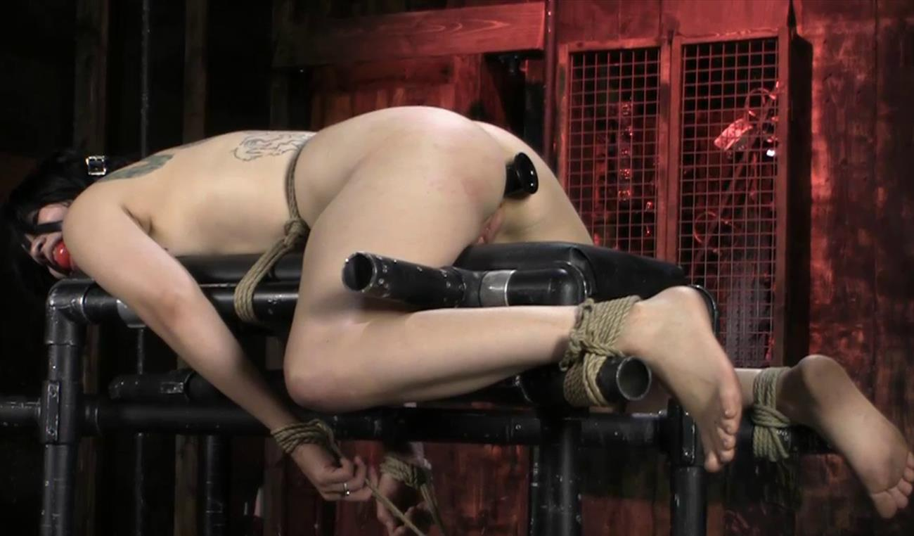Society SM – In Full Bloom – Rubber Necro AKA Sandy Skarsgard - Rubber Necro is naked and bound with ropes and ball gag