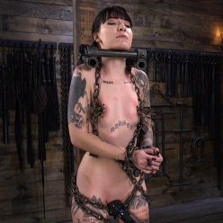 Charlotte Sartre restrained in heavy, cold steel chains, with her neck locked into place with a steel neck trap – February 6, 2020 – Charlotte Sartre