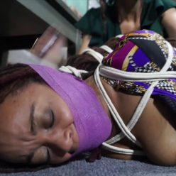 Photo of gagged woman and hogtied woman in restraint chair