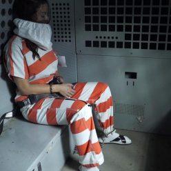 Image of JJ Plush is cuffed in restraint chair bondage