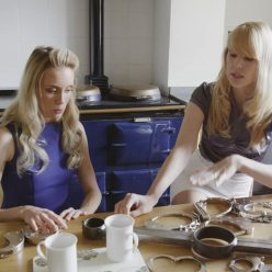 Photo of Ariel Anderssen and Katy Cee with metal bondage items