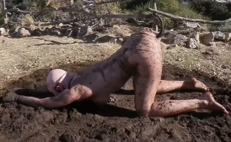 Bondage Life – Stuck In The Mud - Rachel Greyhound is Chained to 2 stakes in the backyard